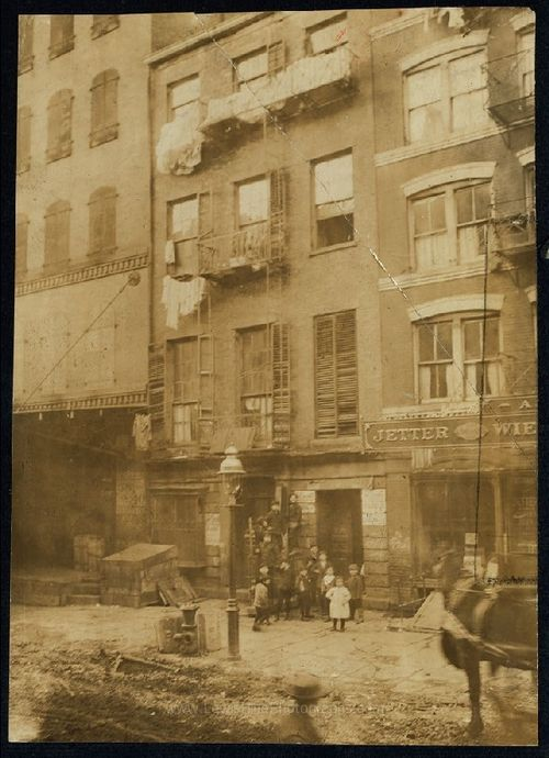 LewisHineTenementHouseWithChildrenInFrontNYNY1910