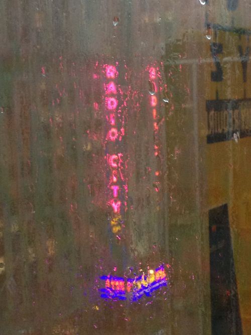 Radio City Marquee In Rain thru window